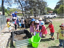 Mawson Pre-schoolers setting up the new vegetable garden in the preschool yard.